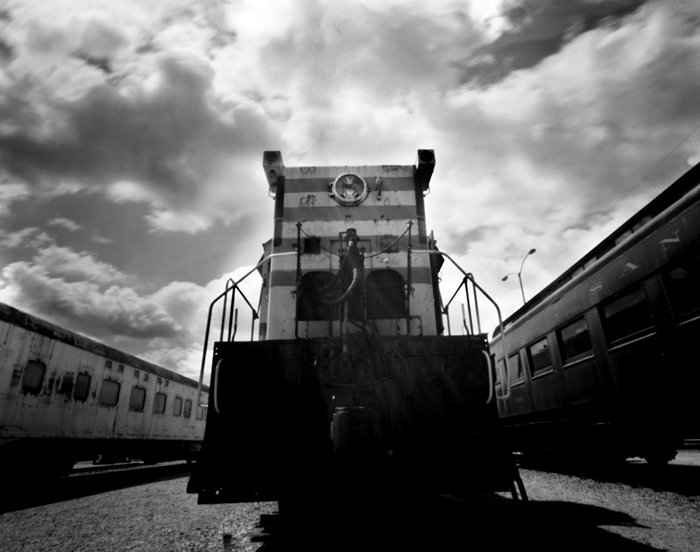 "Taken with a Deardorff 4x5 View camera and a .3mm pinhole at the Arizona Railway Park in Chandler, Arizona."" ""This is the first of 12 photos taken by a 60 year old Deardorff once owned by Cole Weston. A .3mm pinhole was fitted to a standard lensboard and a simple hinged shutter installed on the front."""